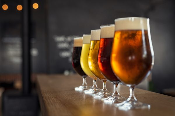 Glasses,With,Different,Sorts,Of,Craft,Beer,On,Wooden,Bar.
