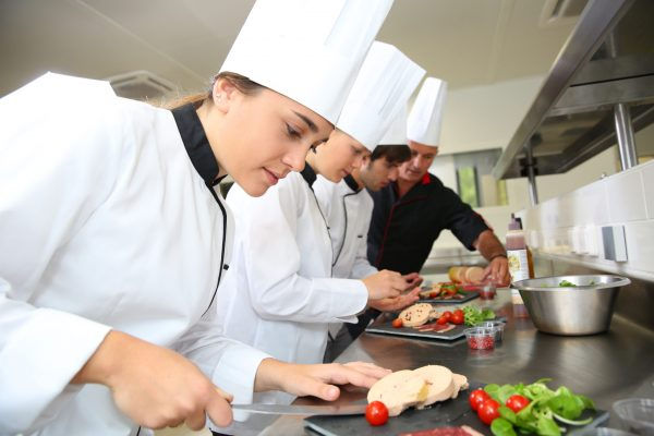 Team,Of,Young,Chefs,Preparing,Delicatessen,Dishes